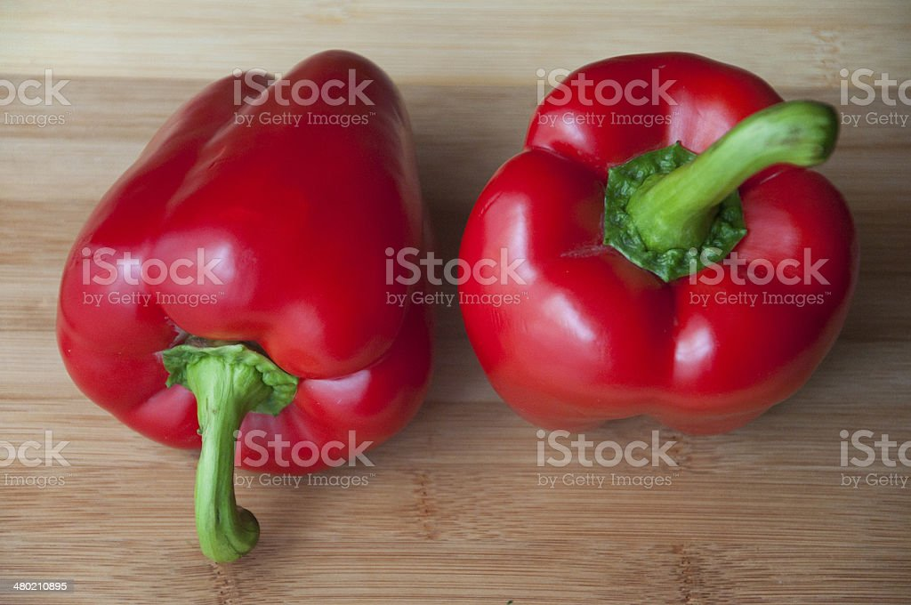 Red pepper on wooden background royalty-free stock photo