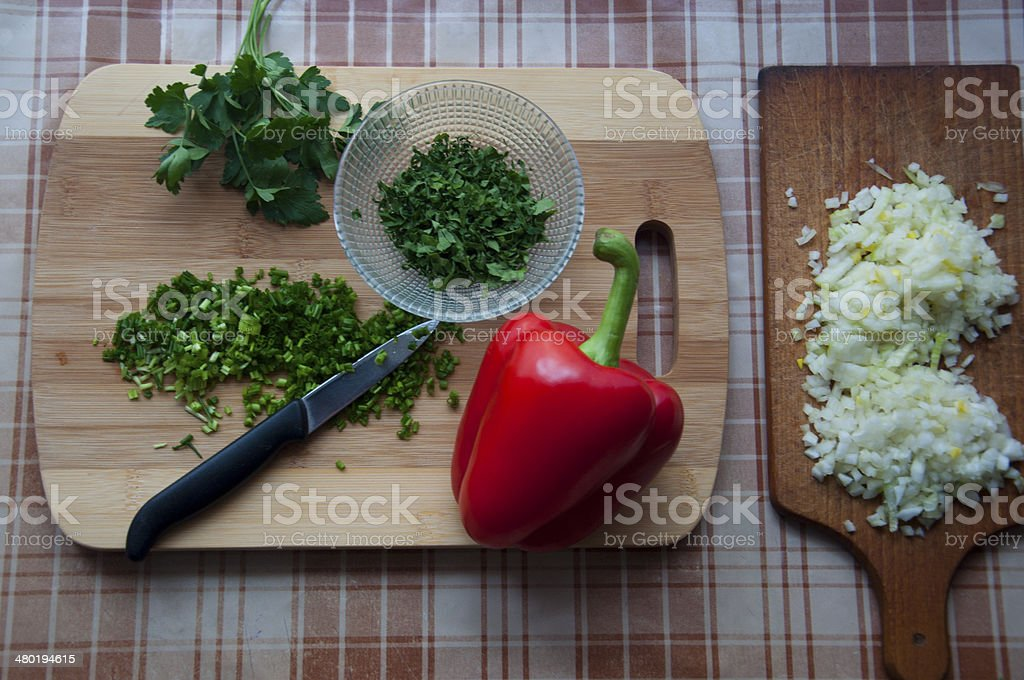 Red pepper, parsley, onion and  chive on wooden table royalty-free stock photo