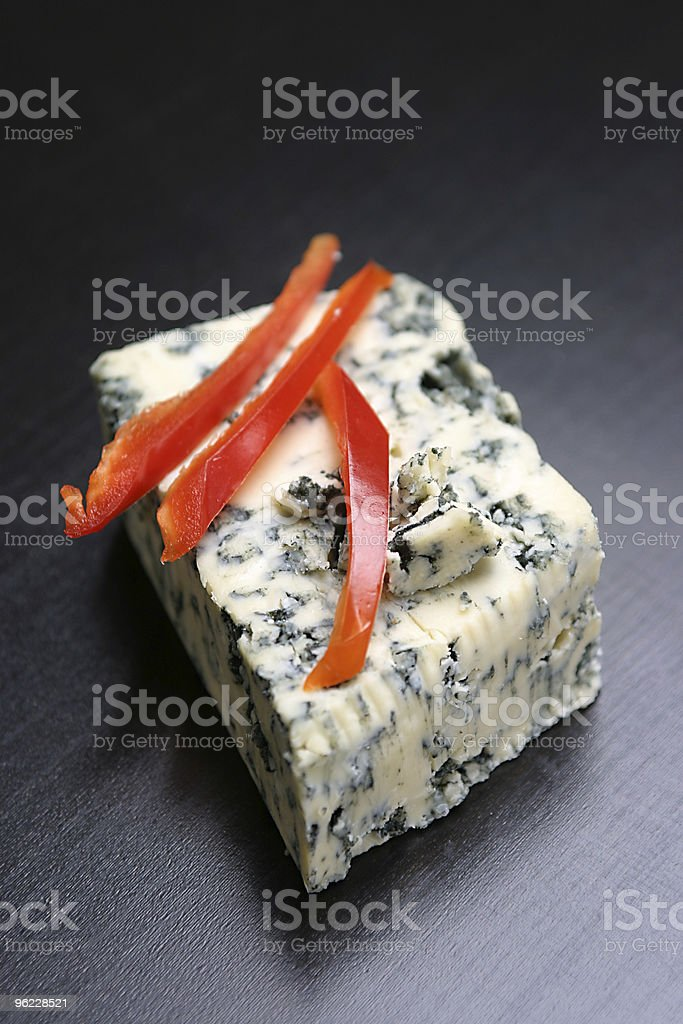Red pepper slices on cheese stock photo