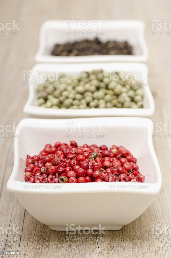 Red peppercorns in vertical format royalty-free stock photo