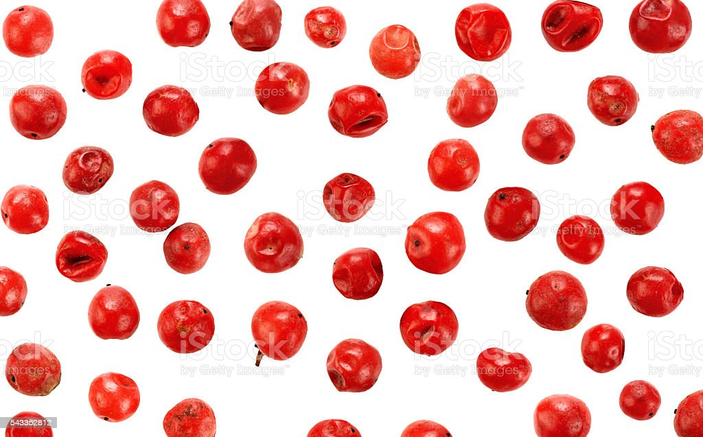 Red peppercorns seeds isolated on white background stock photo