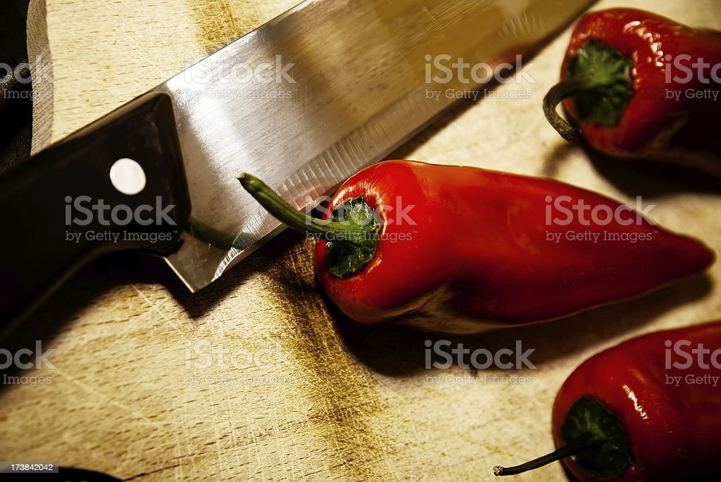 red peppers and chefs knife royalty-free stock photo