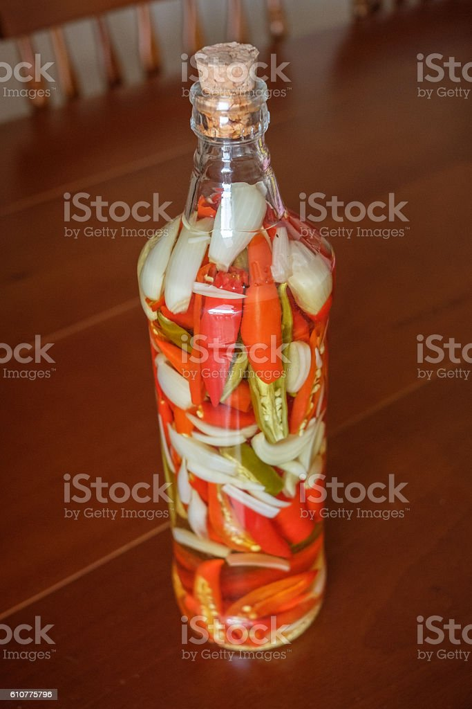 Red Peppers in a bottle stock photo