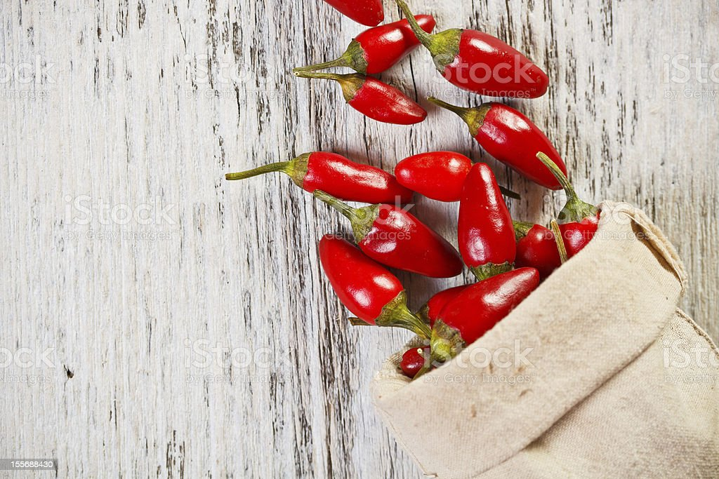 Red peppers in sack royalty-free stock photo