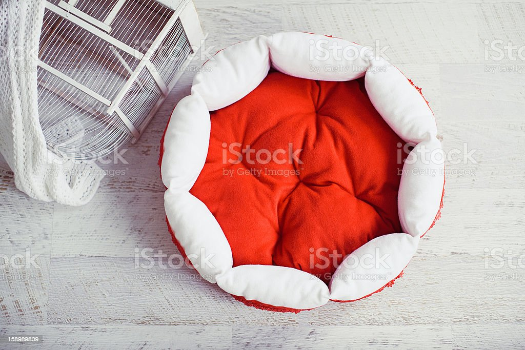 Red pet mattress in the room with cage royalty-free stock photo