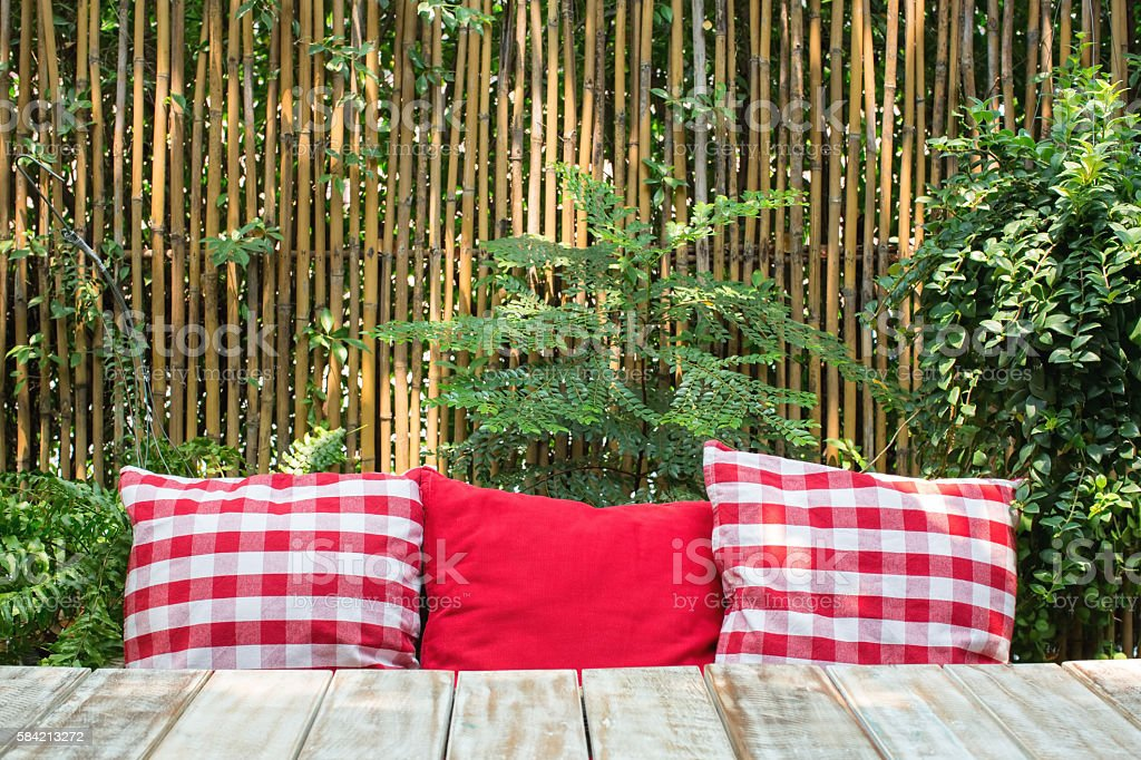 Red phillows on a wooden table stock photo