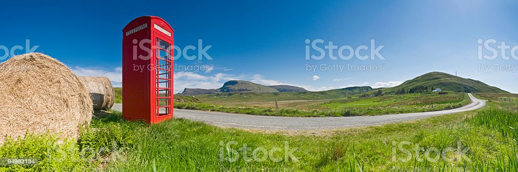 Red phone box in rural island landscape royalty-free stock photo