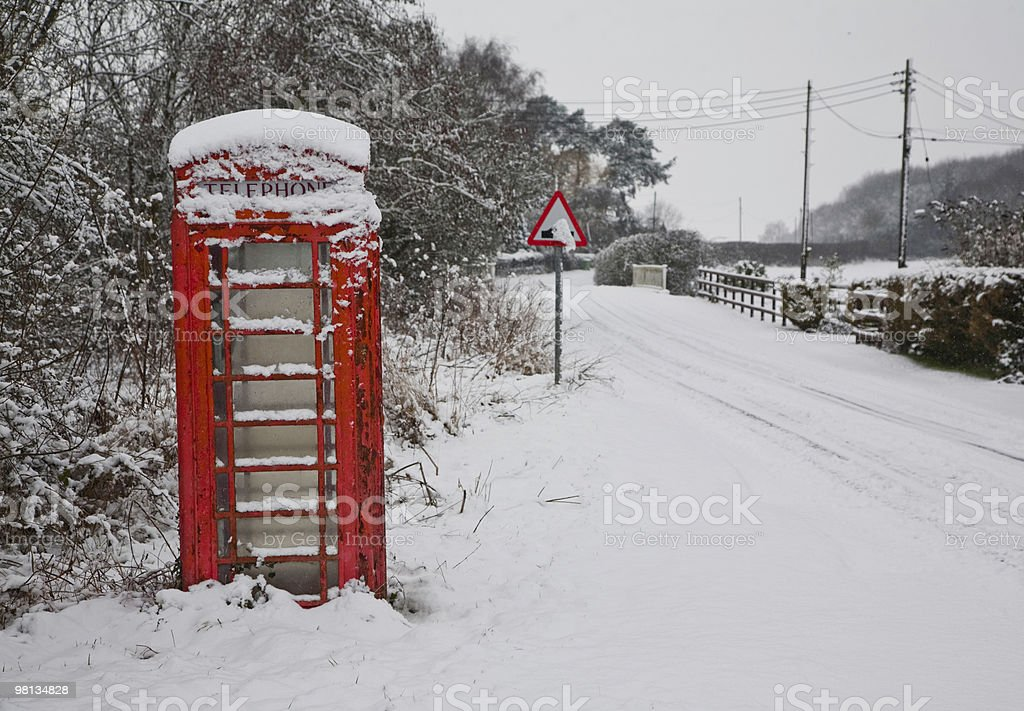 Red phone box in the snow royalty-free stock photo