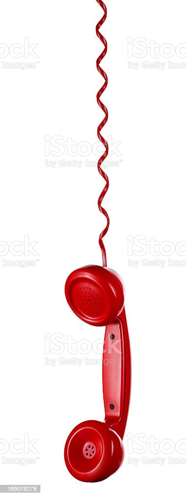 Red Phone Hanging on a White Background stock photo