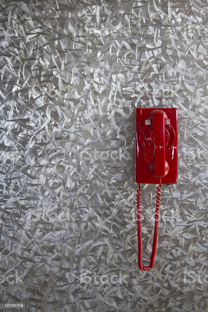 red phone on metal wall royalty-free stock photo