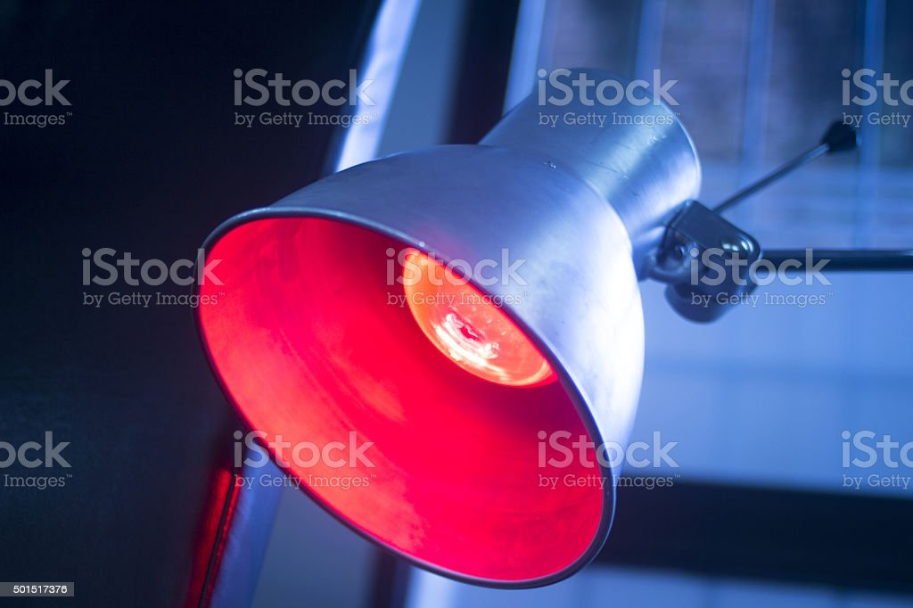 Red physiotherapy heat treatment lamp stock photo