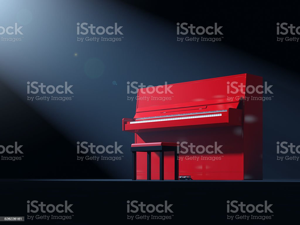 Red piano on stage stock photo