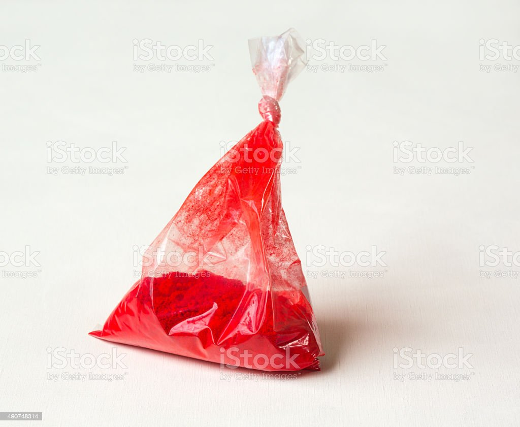Red pigment in a plastic bag stock photo
