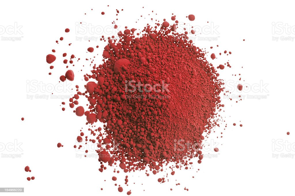 Red pile of pigment powder on white stock photo