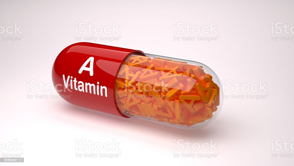 Red pill or capsule filled with vitamin A. stock photo