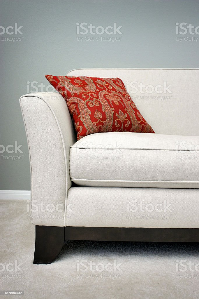 Red Pillow on a Sofa royalty-free stock photo