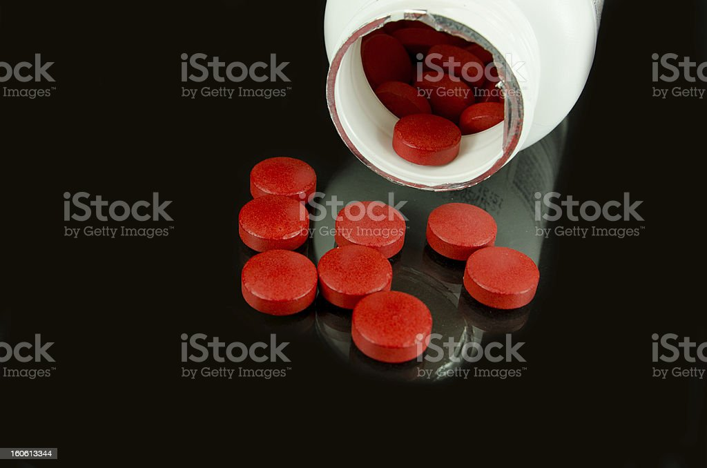 Red Pills and Bottle on Black royalty-free stock photo