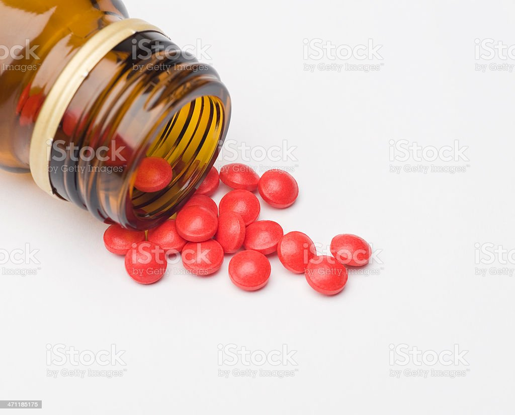 Red pills and container stock photo