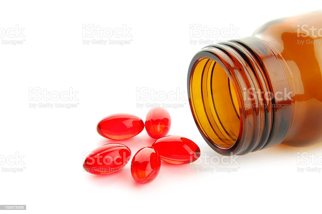 Red pills isolated on a white royalty-free stock photo