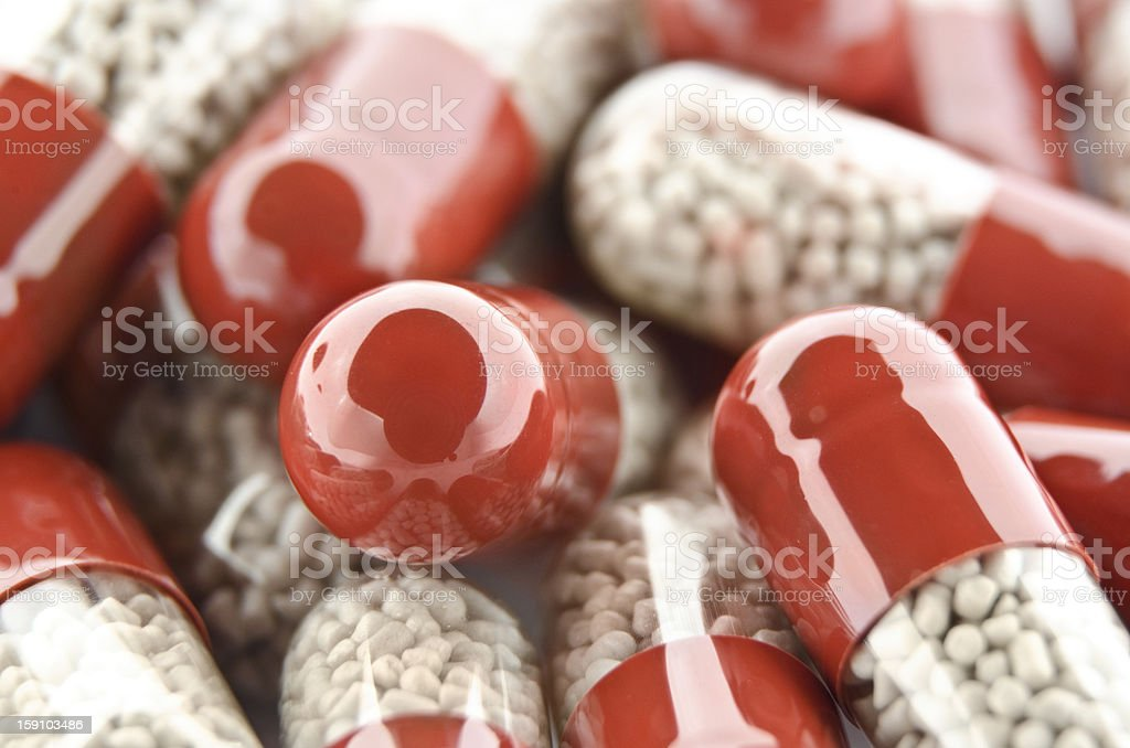 Red pills with beige filling royalty-free stock photo