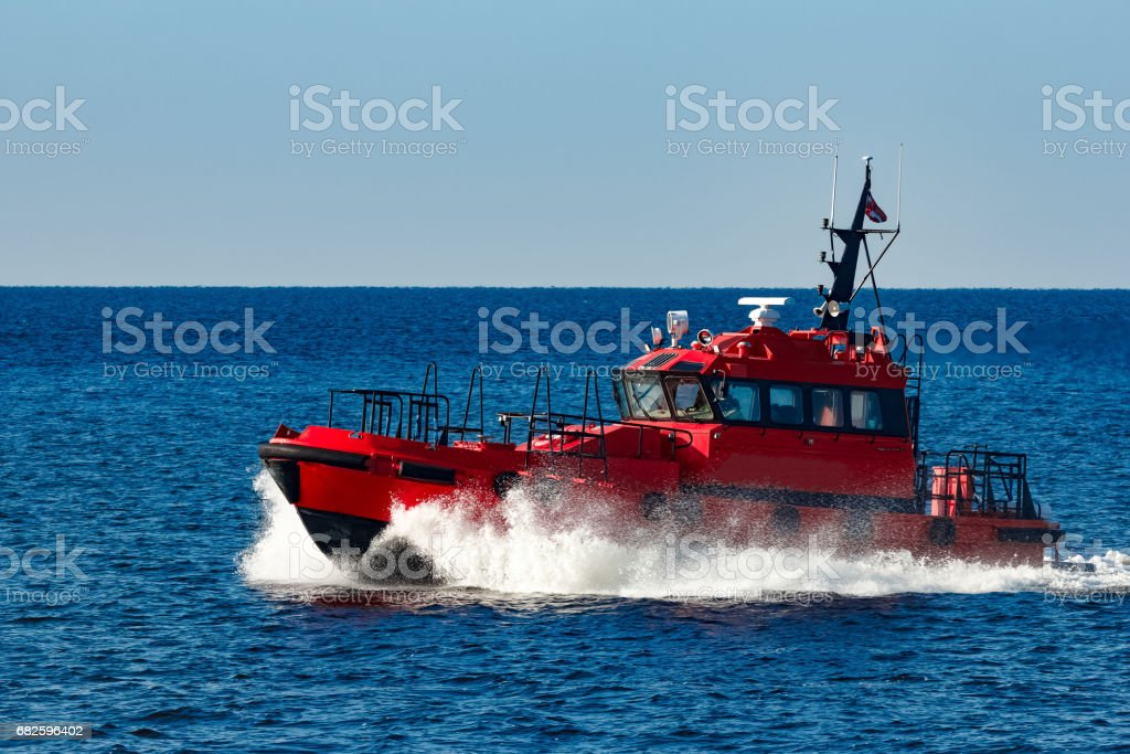 Red pilot boat stock photo