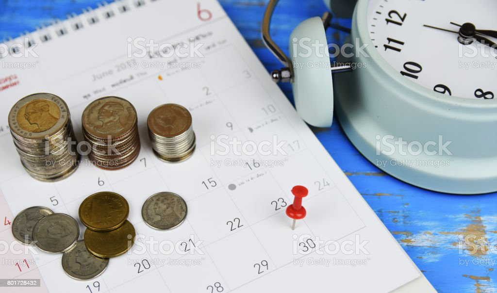 Red pin money planning this month. stock photo