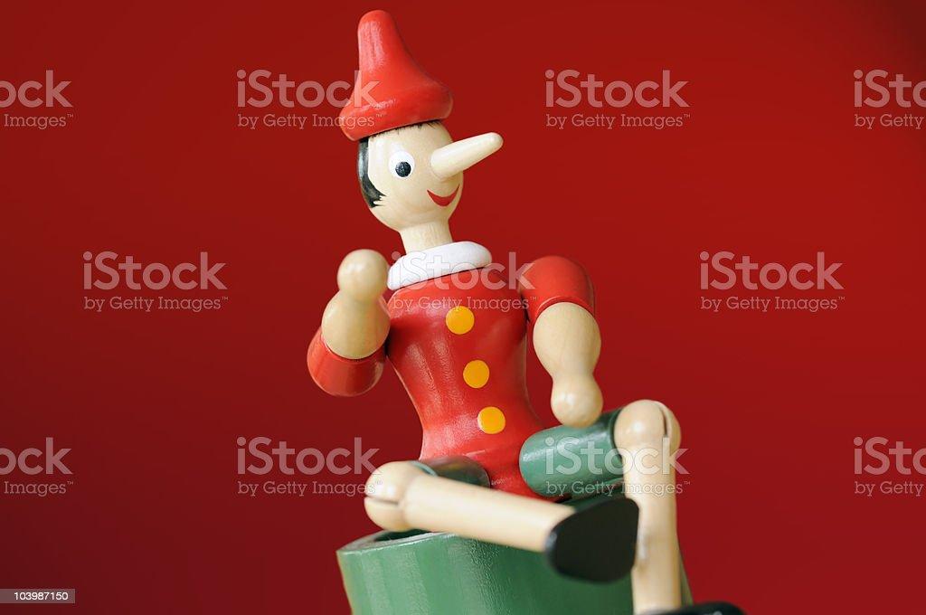 Red Pinocchio stock photo