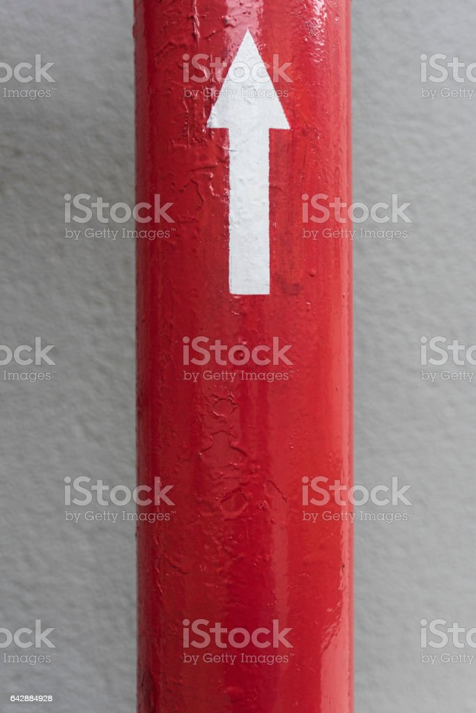 Red Pipe with Directrion stock photo