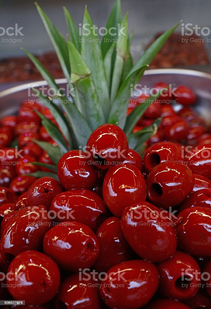 Red pitted Cerignola olives in oil close up stock photo