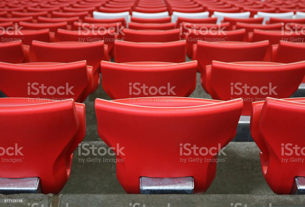 red plastic chairs at the stadium stock photo