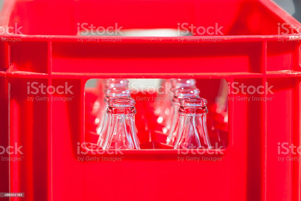 Red Plastic Crate with Empty Glass Bottles royalty-free stock photo