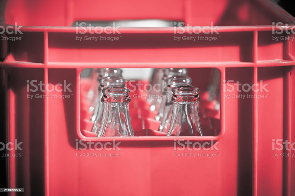 Red Plastic Crate with Empty Glass Bottles stock photo