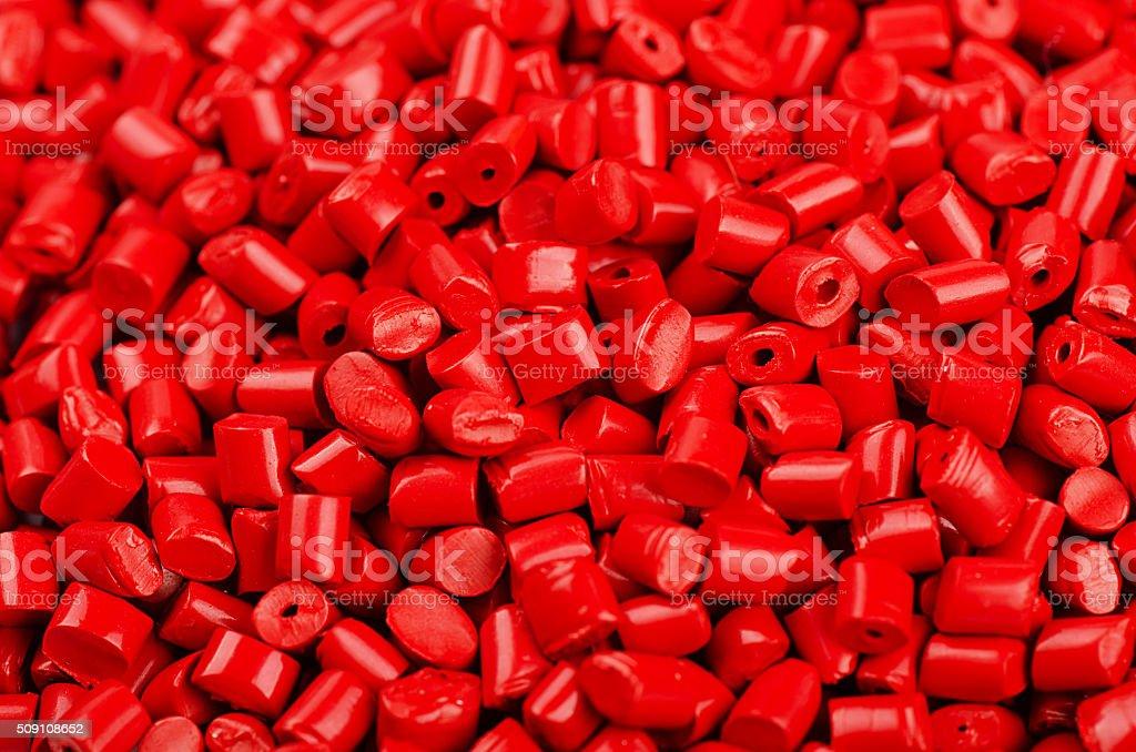 Red plastic grains stock photo