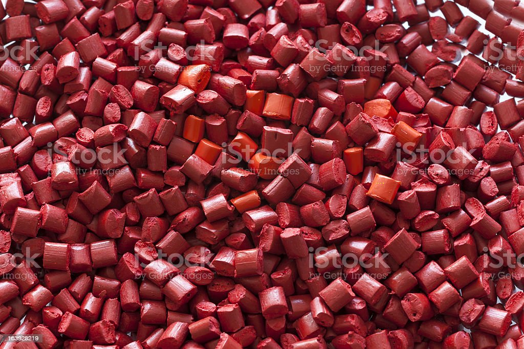 Red plastic granule masterbatches royalty-free stock photo