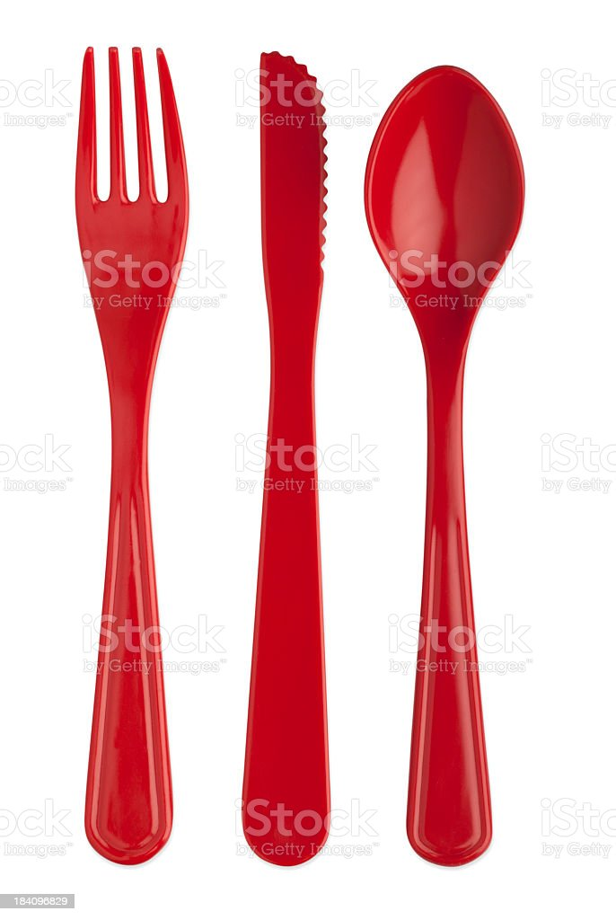 Red plastic knife fork and spoon with paths stock photo