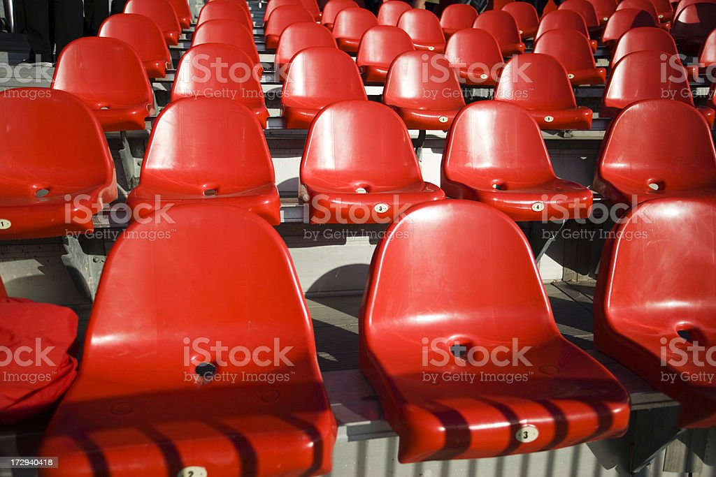 Red plastic stadium seats royalty-free stock photo