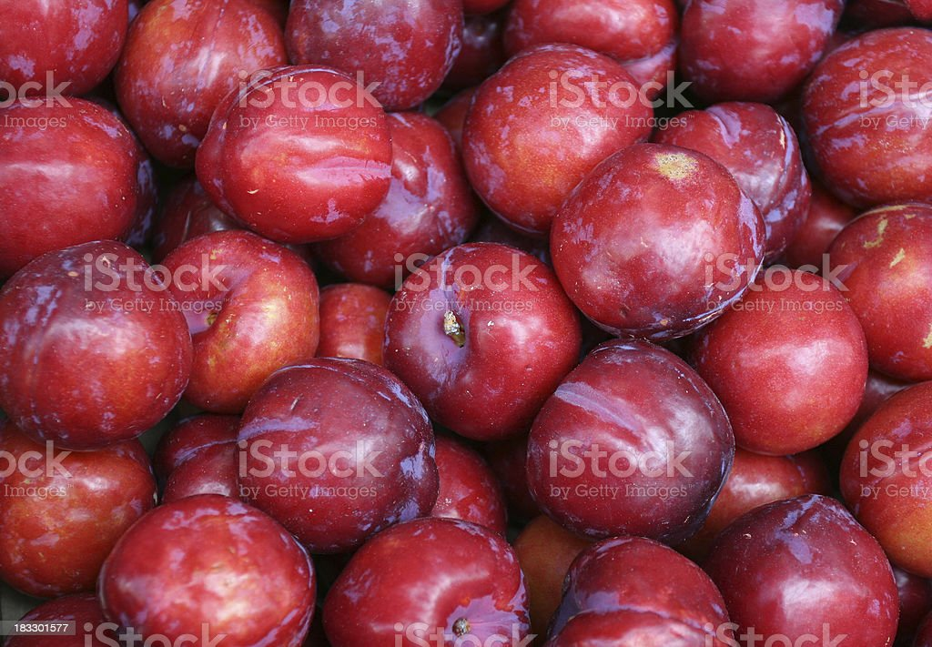 Red plum background stock photo