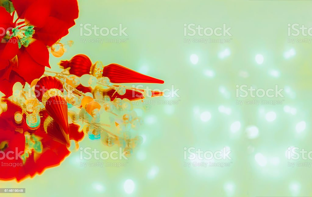 Red Poinsettia and Christmas Ornaments are reflected in green (P) stock photo