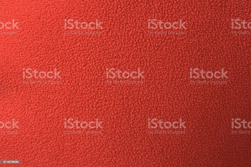 Red polar fleece material texture stock photo