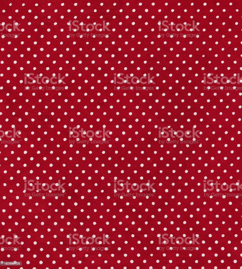 red polka dot paper stock photo