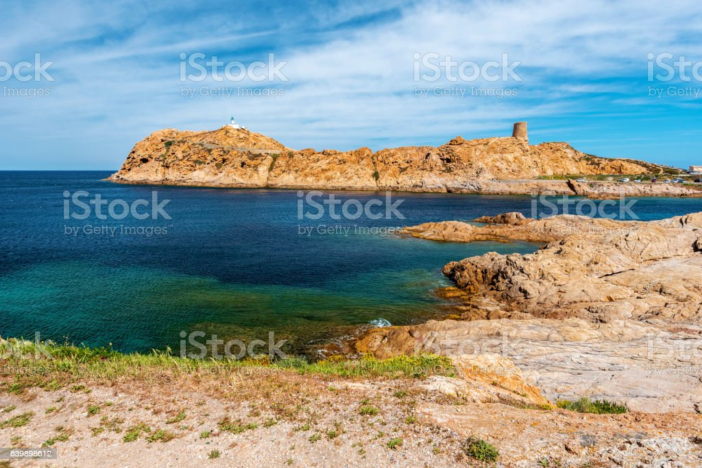 Red Porphyry rocks landscape of Pietra Islet in Corsica stock photo