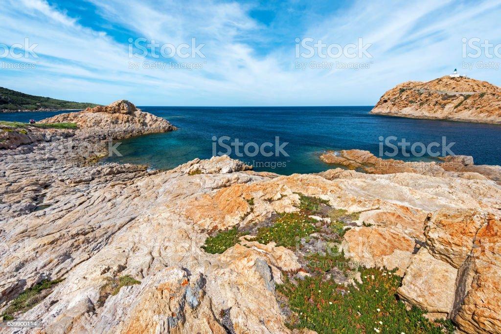 Red Porphyry rocks of Pietra Islet in Corsica stock photo