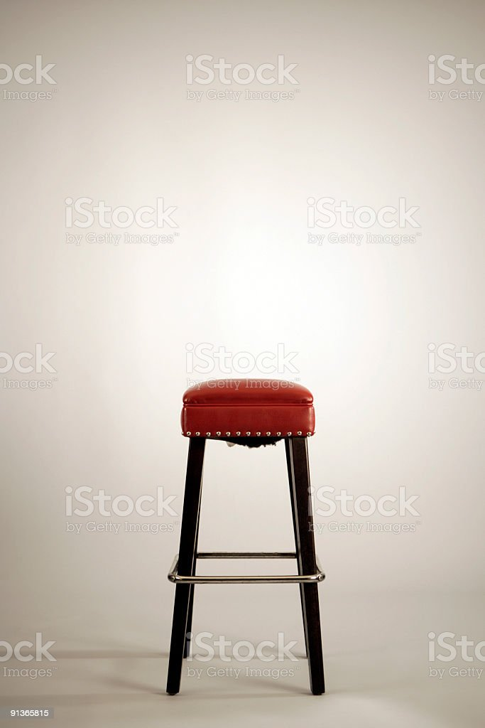 Red Posing Stool on White Photo Backdrop royalty-free stock photo