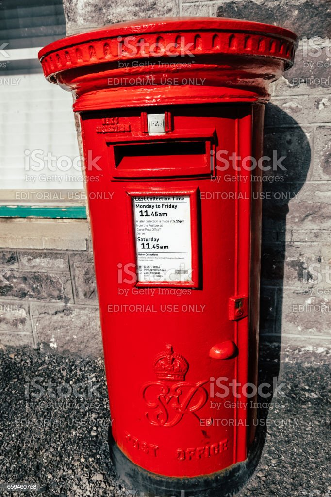 Red Postbox in the United Kingdom stock photo