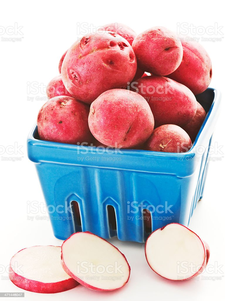 red potatoes. blue carton. 2 royalty-free stock photo