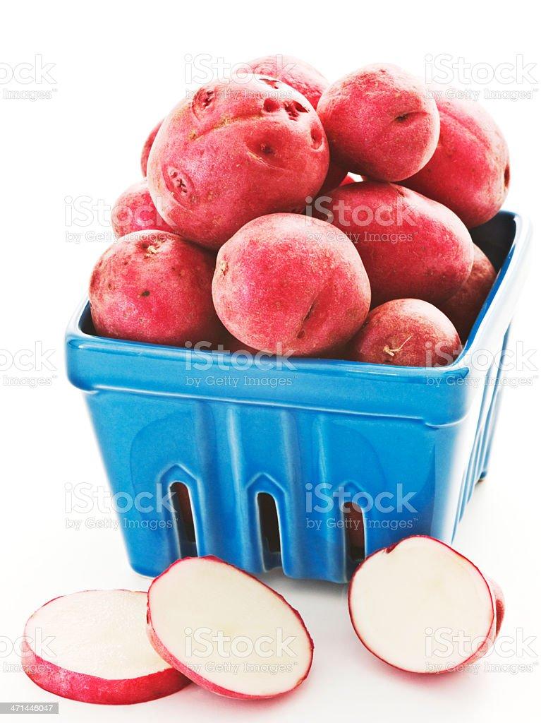 red potatoes. blue carton. 2 stock photo