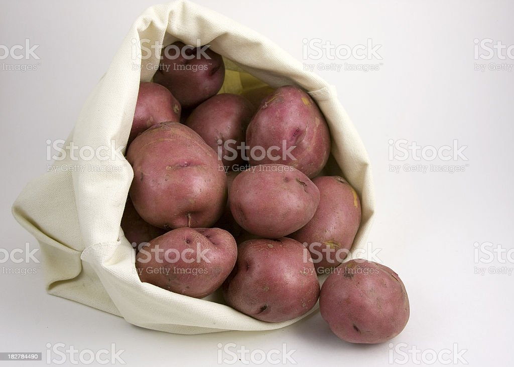 Red Potatoes in a Canvas Bag royalty-free stock photo