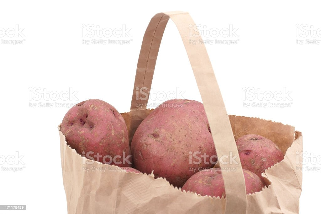 red potatoes in paper bag royalty-free stock photo