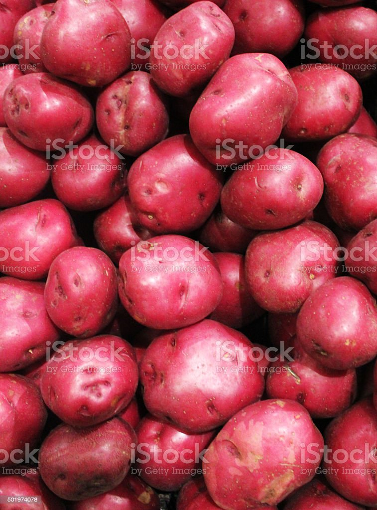 Red Potatoes on display stock photo