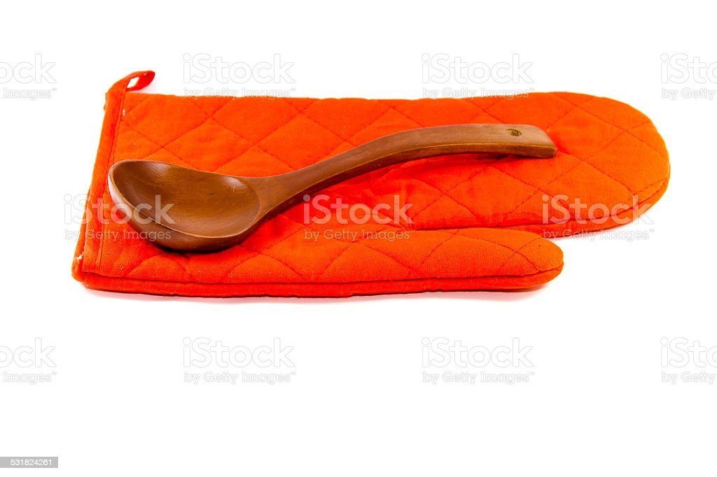 Red Potholder Glove with Wooden Soup Spoon stock photo
